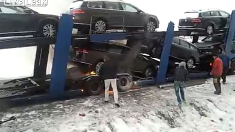 Watch bystanders try to put out fire on transporter full of new Volkswagens