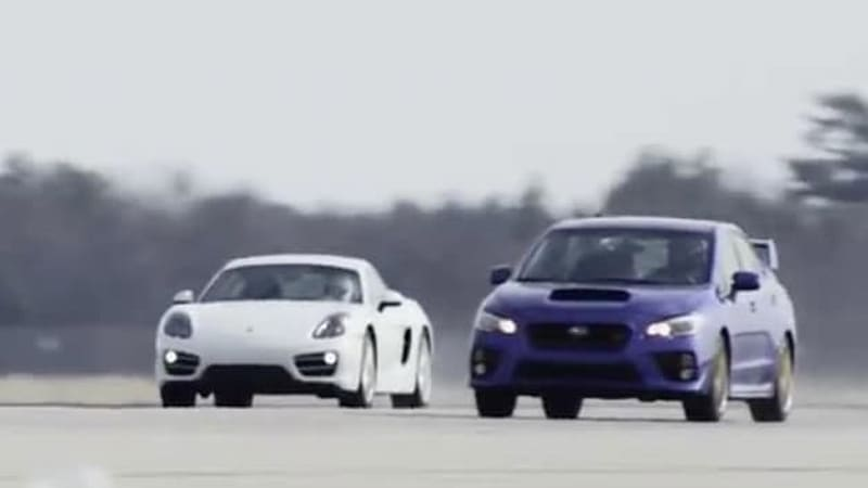 Which is quicker in the standing mile, a Subaru WRX STI or a Porsche Cayman?