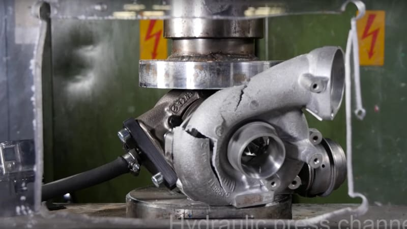 Watch a turbocharger crack under the stress of a hydraulic press