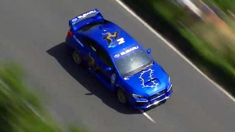 Watch Mark Higgins whomp the Isle of Man TT course in a 2015 WRX STI