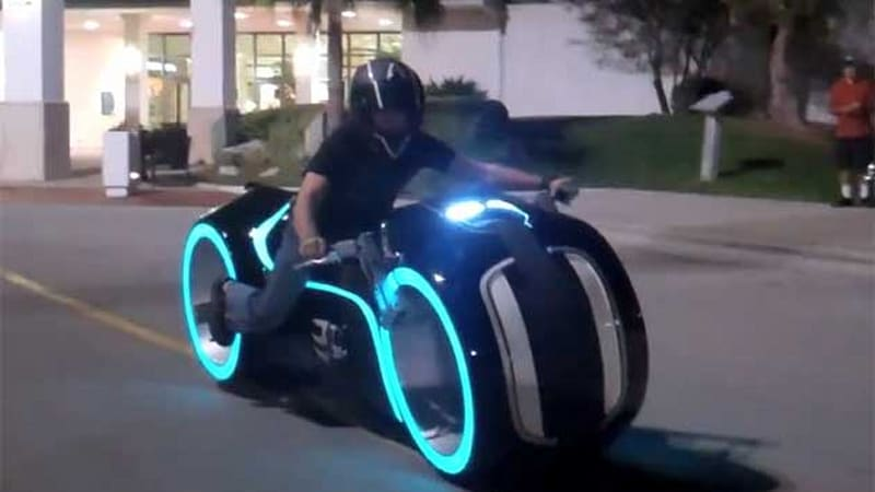 Real electric tron light cycle rolls up to suburbia autoblog - Replica mobel legal ...