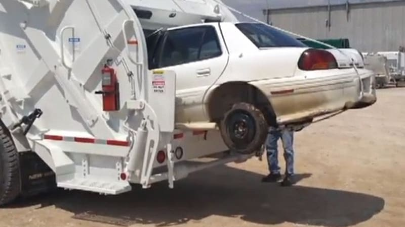 Watch This Garbage Truck Consume A Pontiac Grand Am Autoblog