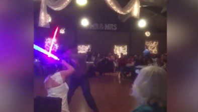 Couple Swaps 1st Dance For Lightsaber Duel