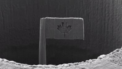 Microscopic Canadian Flag Mounted In Penny