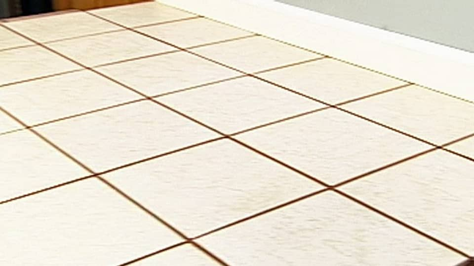 Can you install ceramic tile over linoleum