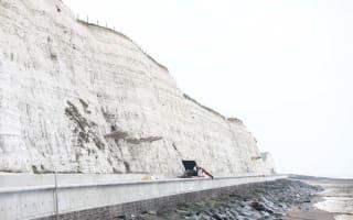 Motorist survives 80ft cliff plunge