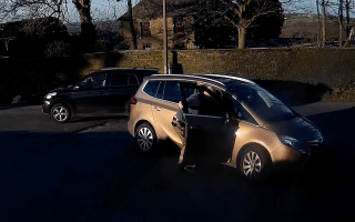 Watch as a Vauxhall Zafira rolls away from its owner as he confronts lorry driver