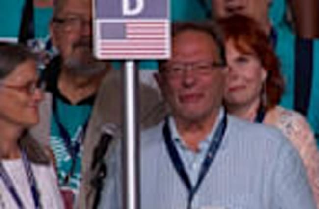 Emotions run high as Larry Sanders casts vote for little brother, Bernie