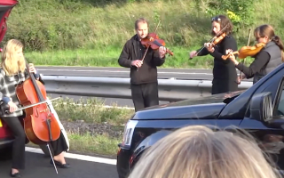 Music to our ears: String quartet serenades motorists on gridlocked M5
