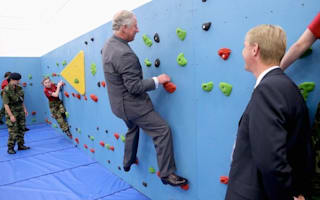 Walking on heir: Prince Charles tries wall climbing on Jersey trip