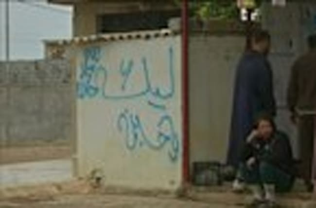 Soldiers' graffiti in Iraq's Mosul angers Sunni Muslims