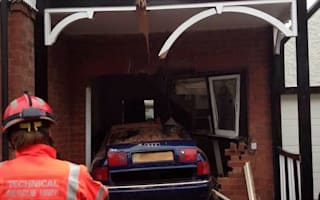Shut the front door! Powerful Audi saloon smashes into family home