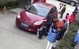 People lift car off trapped child