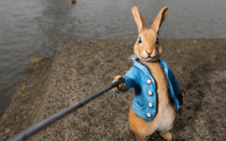 Why is Peter Rabbit posing with a selfie stick in London?