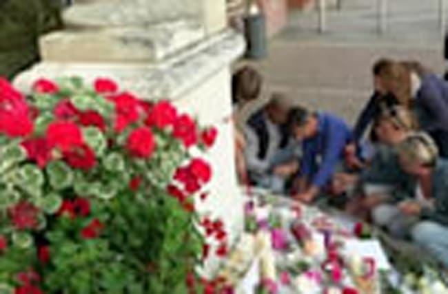 Candles and flowers for murdered priest