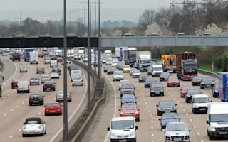 Woman dies after falling from bridge over M25