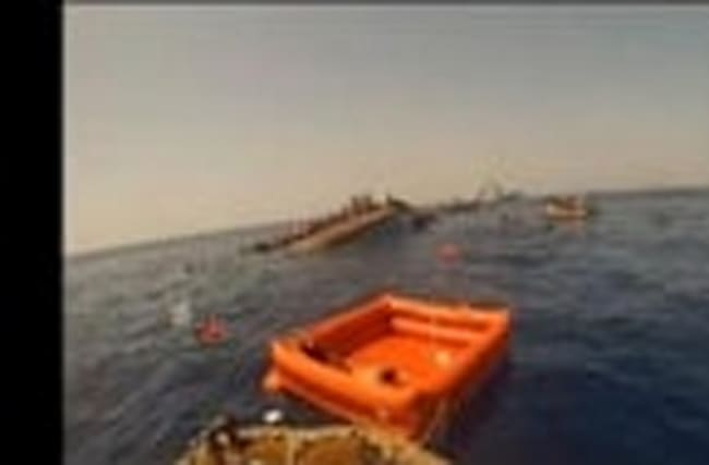 Captain says sight of capsized boat was paralyzing