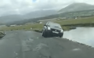 Driver rescued from sea after returning to stranded car