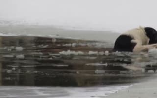 Half-naked hero saves dog fallen through ice in Russia