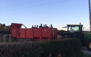 Football team gets lift in tractor trailer after coach breaks down