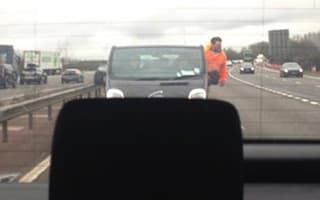 Workman photographed in high-speed motorway stunt