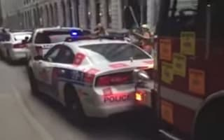 Video: Montreal fire engine rams police cars out of the way