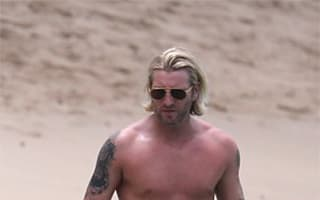 Robbie Savage spotted on family beach break in Barbados