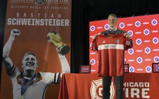 Good luck winning the World Cup - Nowitzki welcomes Schweinsteiger to US