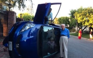 Elderly couple flip car and pose for photos while they wait for help