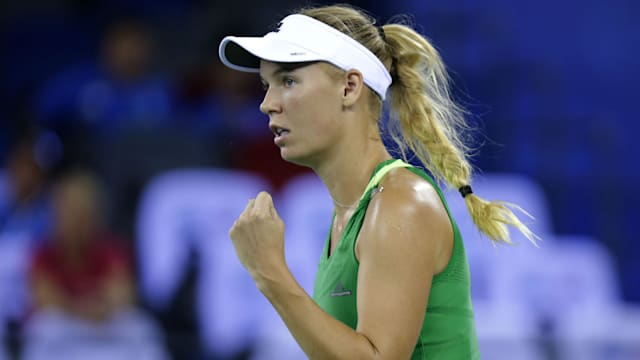 Wozniacki triumphs over injured Mladenovic