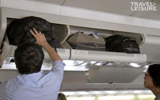 The right way to put your luggage in the overhead bin on a plane
