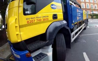 Video: Biker has narrow escape from turning lorry