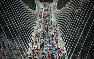 """China's glass-bottomed bridge closes after being """"overwhelmed by visitors"""""""