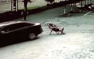Man relaxing on deckchair struck by runaway car