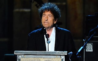 Bob Dylan expresses awe at receiving Nobel Prize in letter read out at award ceremony