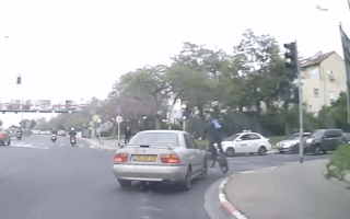 Mad cyclist has incredible near miss with turning car
