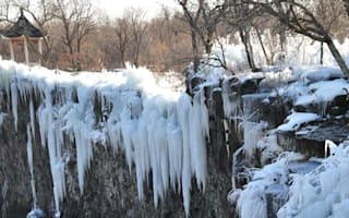 Extreme diving: Man jumps off frozen waterfall in China for 'good health'
