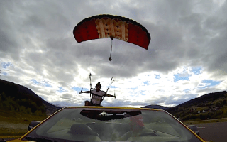 Daredevil skydives into a moving Ford Mustang