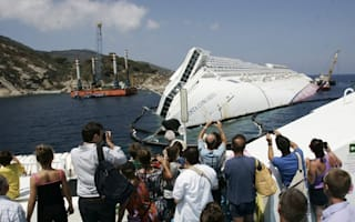 Tourists flock to see shipwrecked Italian cruise liner Costa Concordia