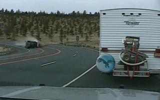 Police dashcam captures scary truck rollover crash