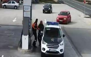 Speeding car just misses police officers in petrol station crash