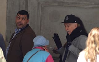 Bruce Forsyth approached by beggar outside museum in Florence