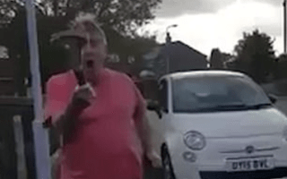 Watch as a man smashes a car window with a hammer during parking row