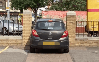 Driver tries to squeeze car through incredibly small gap