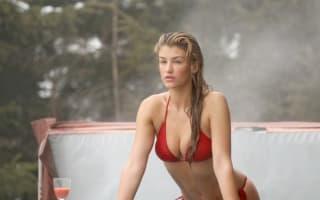 Amy Willerton does red bikini photo shoot in hot tub on Switzerland ski holiday