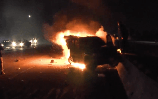 Dramatic video shows photographer rescuing man from burning car