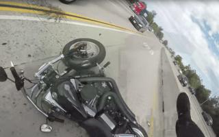 Biker winds up on car roof following terrifying crash