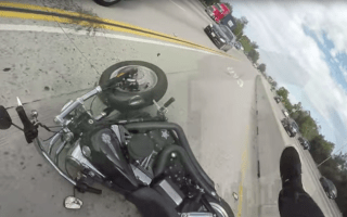 Biker winds up on car roof following terrifying crash