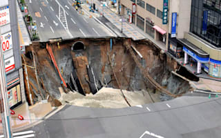 Incredible Japanese workers fix giant sinkhole in two days