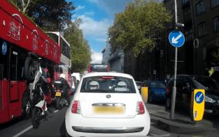 Biker flips over handlebars in shocking video